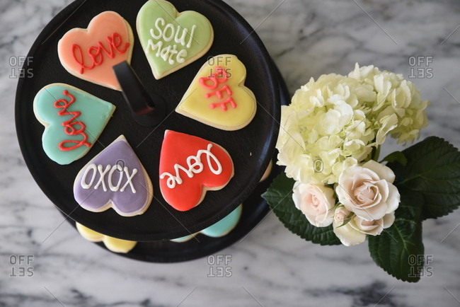 Valentine cookies beside flower arrangement