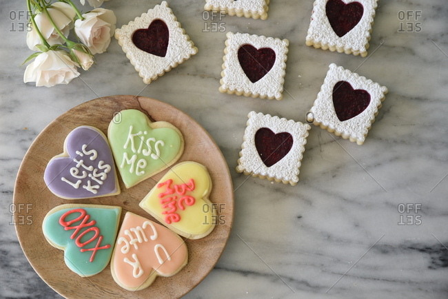 Valentine cookies on a round wooden board