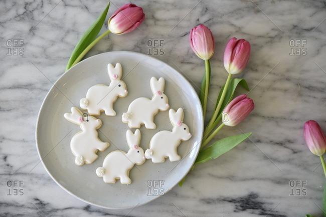 Easter cookies beside tulips