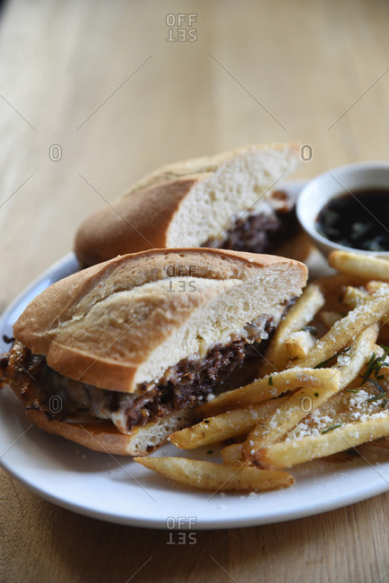 French dip sandwich served with fries