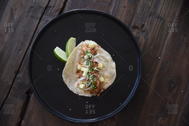 Overhead view of small taco with pesto