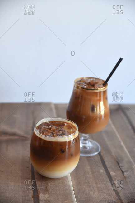 Two iced cocktails topped with cinnamon