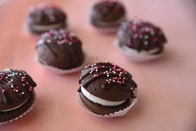 Stuffed chocolate cookies with sprinkles