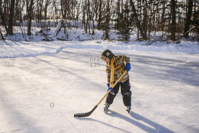 Young boy practicing ice hockey