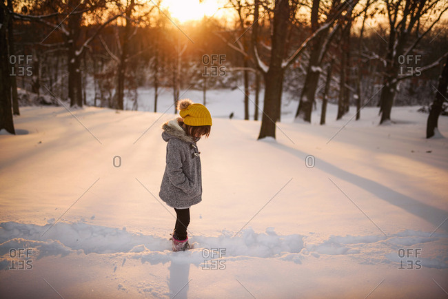 Portrait of young girl standing outside in the snow