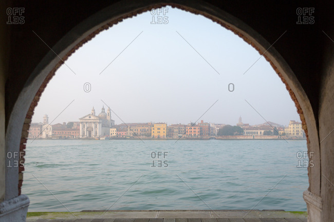 Venice Skyline in the Mist Viewed through an Arch from the Giudecca Island Seafront