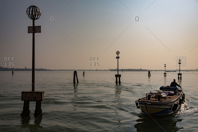 March 20, 2014: Boat Among the Docks of the Lagoon of Venice