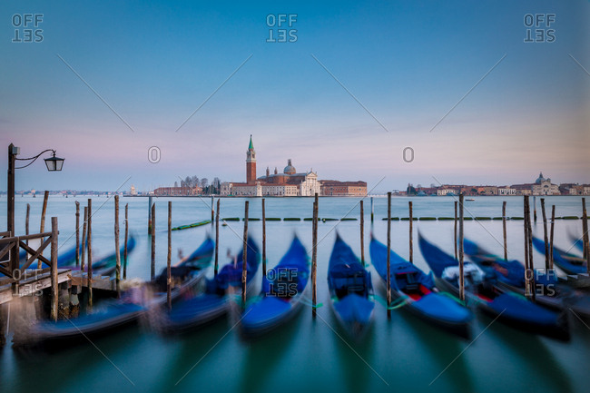 Gondolas Floating on the Water in the San Marco Square Harbor with the San Giorgio Basilica in the Background at Sunset