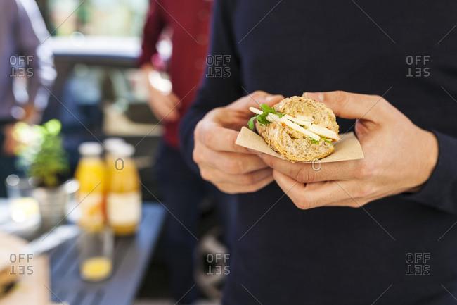 Man holding a sandwich