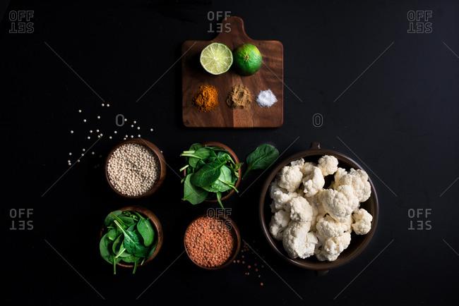 Overhead view of fresh ingredients on dark background
