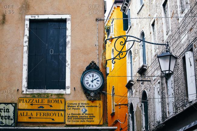 Venice, Italy - November 9, 2010: Wall signs on street corner