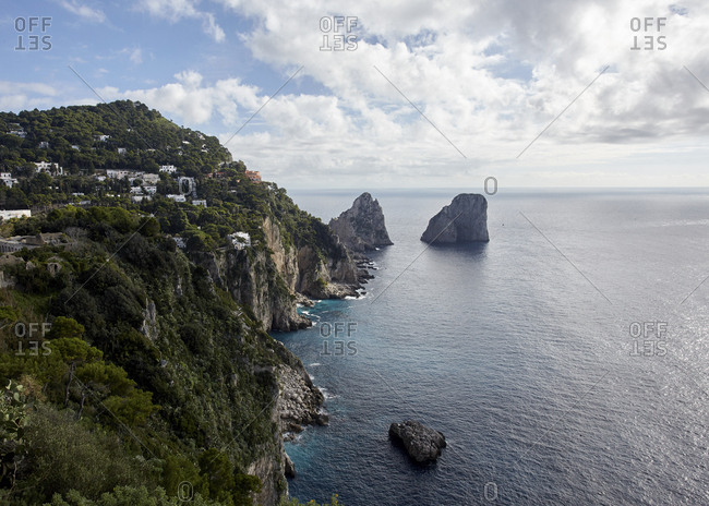 View of the iconic Faraglioni rocks from the cliffside trail on the Mediterranean island of Capri, Italy