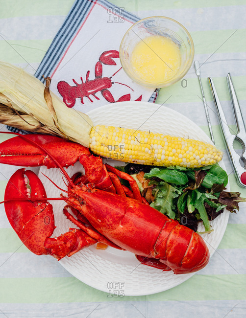 Lobster served with an ear of corn and salad