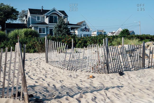 Houses along sandy beach in Cape Cod