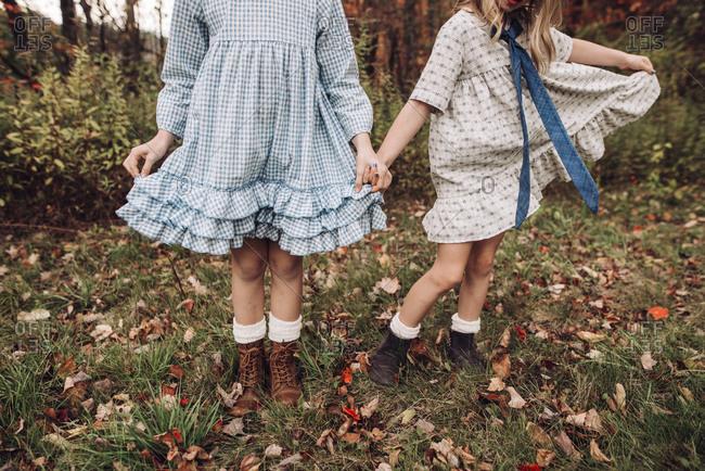Girls playing dress-up outside