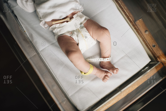 Tiny baby lying on hospital blanket
