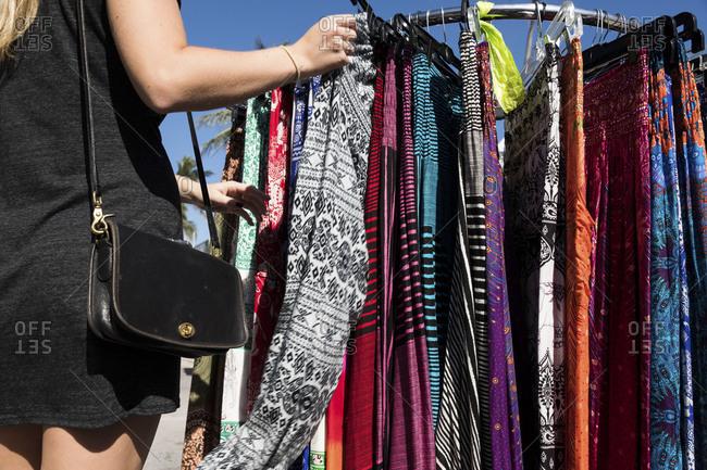 Woman shopping for clothes at a beach vendor in Miami, Florida