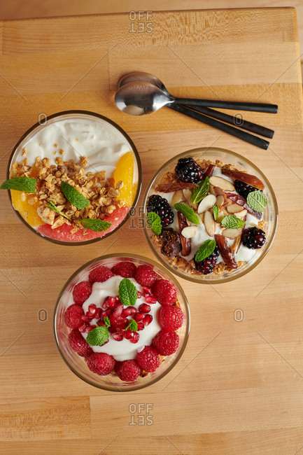 Top view of fruity breakfast parfait trio
