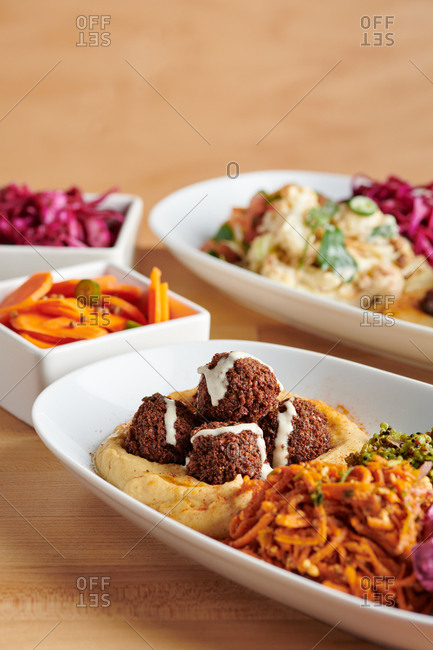 Falafel and hummus and spread of toppings