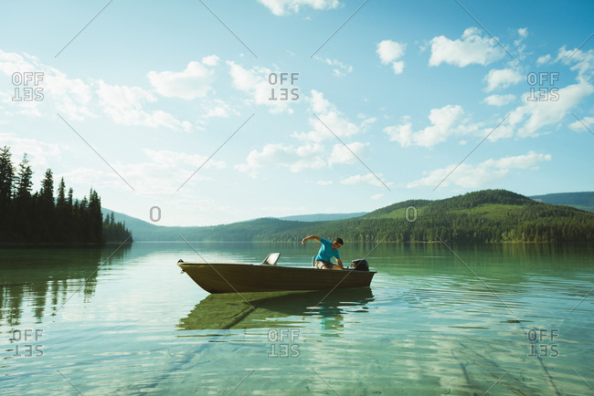 Man travelling in motorboat on a lake