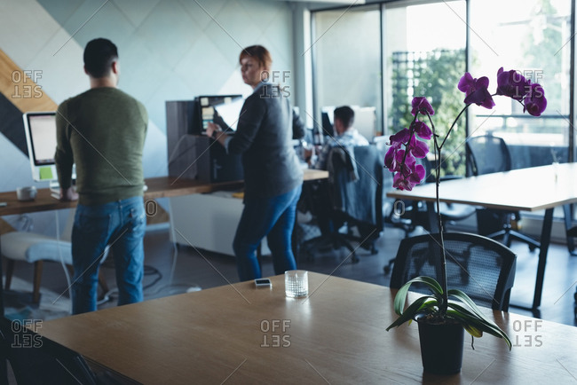 Business colleagues interacting with each other while working in office