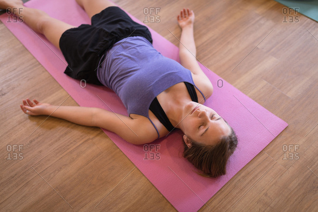 Young woman meditating in fitness club