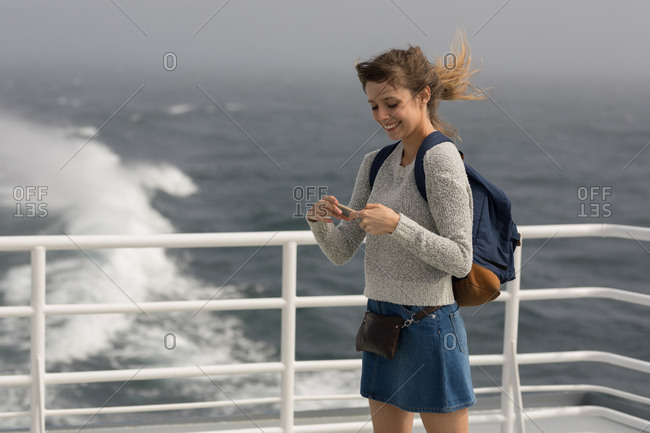 Woman using mobile phone mobile phone on cruise ship