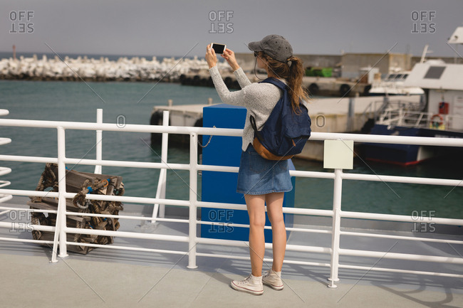 Woman selfie with mobile phone on cruise ship