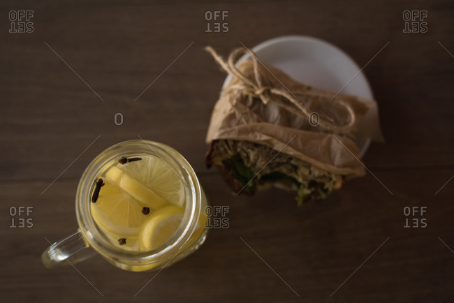 Overhead of  lemon tea jar with wrap food on plate in cafe