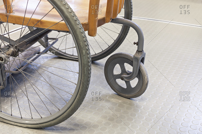 Detail of rear wheel of antique wheelchair