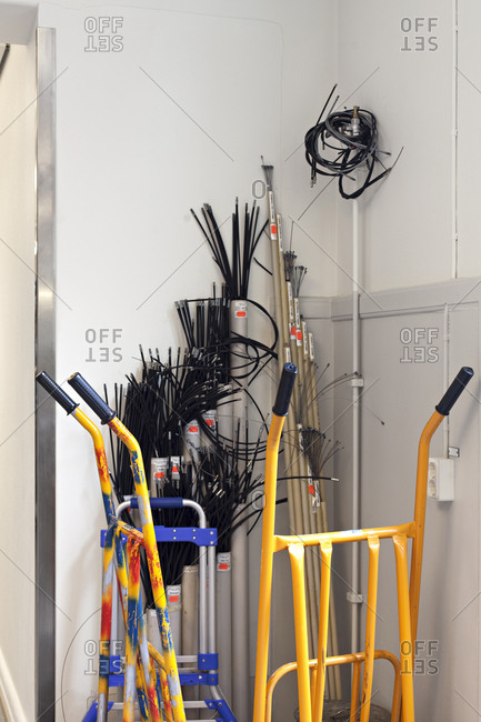 Cables and hand trucks arranged in corner ready for use
