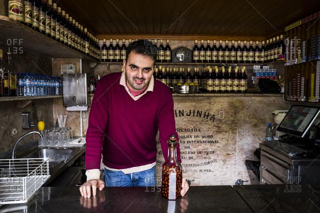 Lisbon, Portugal - March 28, 2016: A ginjinha barman