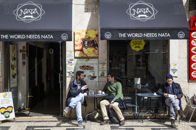 Lisbon, Portugal - March 28, 2016: People at a street cafe in the Baixia area