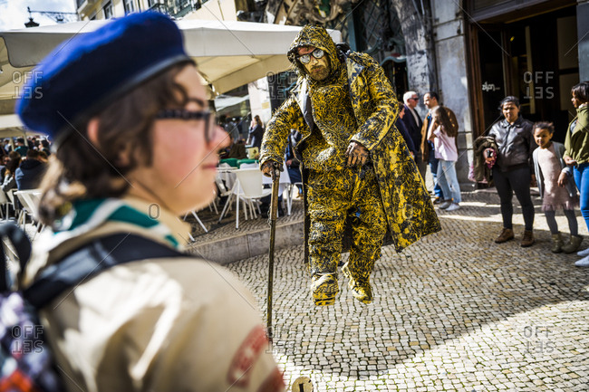 Lisbon, Portugal - March 31, 2016: A street performer outside the Cafe A Brasiliera