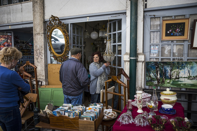 Lisbon, Portugal - March 29, 2016: A woman talking to a customer at the Thieves Market
