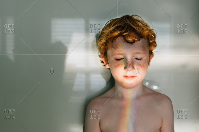 Rainbow light on young boys face
