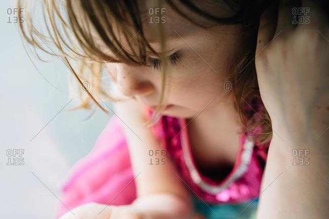 Close up of a little girl wearing pink dress