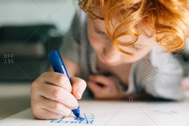 Boy coloring with markers