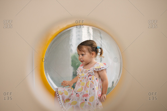 Toddler girl playing on a jungle gym