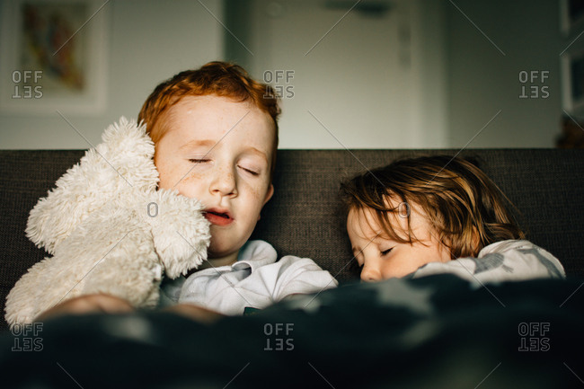 Two kids sleeping side by side