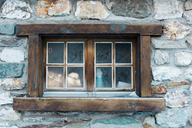 Window in a stone wall with finger drawings