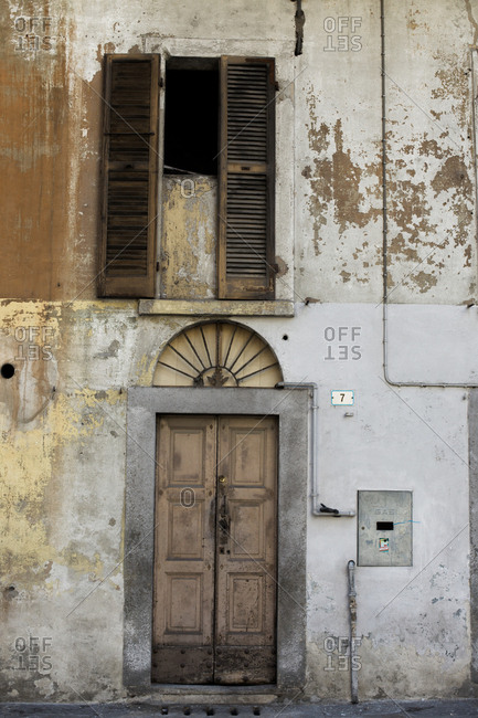 Decaying facade of building in Italy