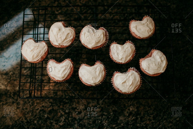 Heart shaped cupcakes on a cooling rack