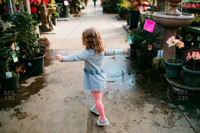 Little girl walking through garden center