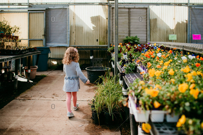 Young girl walking through garden center