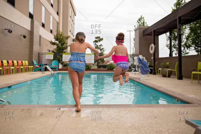 Girls jumping into the pool