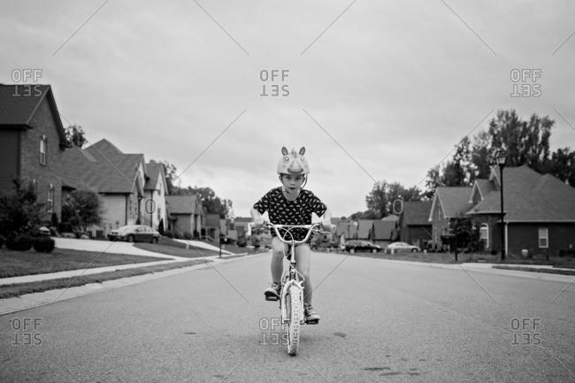 Black and white of girl on bike