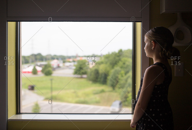 Girl looking out the side of a window