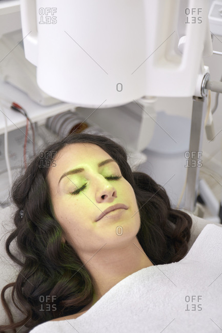 High angle view of patient having light therapy in medical clinic
