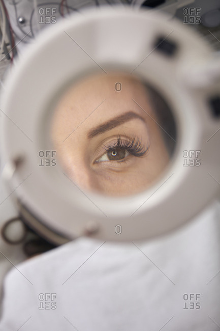 Close-up of patient eye seen through magnifying glass at medical clinic